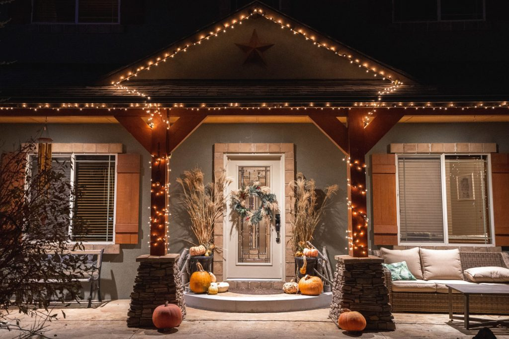 doorstep decorated with pumpkins and fall decor